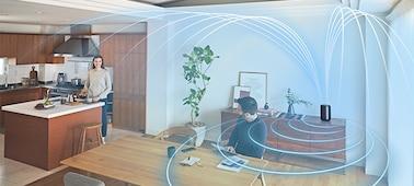 Snímek znázorňující okolní zvuk zaplňující obývací pokoj